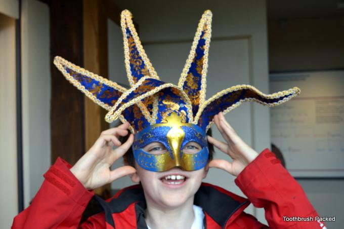 child wearing tudor mask